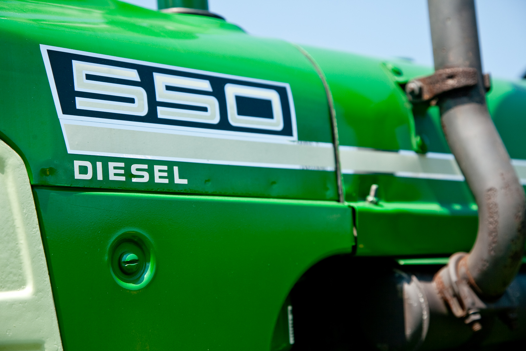 Badge Detail of a 1962 Oliver 550 Diesel Tractor at the Shirktown Thresherman